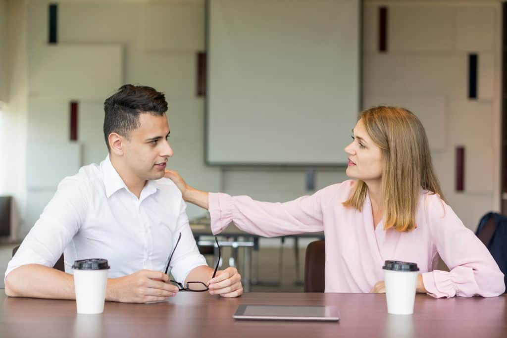 business woman showing empathy to co-worker